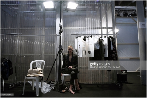 A model sits in the backstage ahead of the Elie Saab Women's Fall-Winter 2020-2021 Ready-to-Wear collection fashion show in Paris, on February 29, 2020. (Photo by Anne-Christine POUJOULAT / AFP) (Photo by ANNE-CHRISTINE POUJOULAT/AFP via Getty Images)
